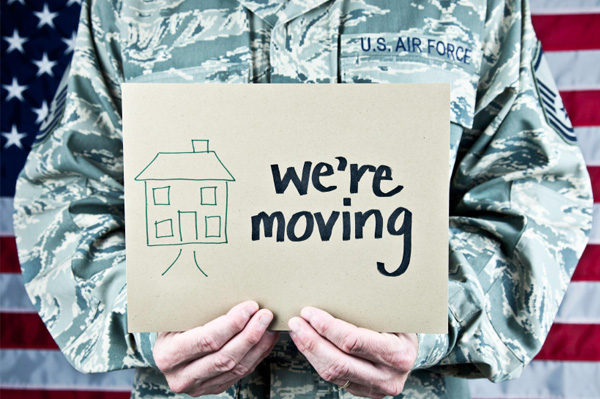 military-man-holding-were-moving-sign[1]